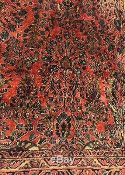 An Antique Vintage Design Sarouk Persian Rug