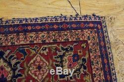 Antique vintage large bordered patterned Persian rug 77 x 56