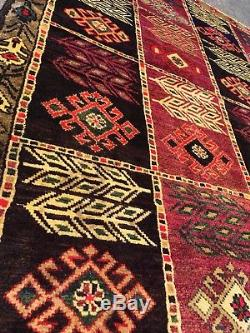Vintage antique persian handmade rug with purple and multi color design % wool